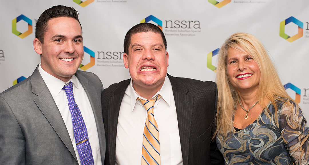 Three people smiling together at NSSRA event