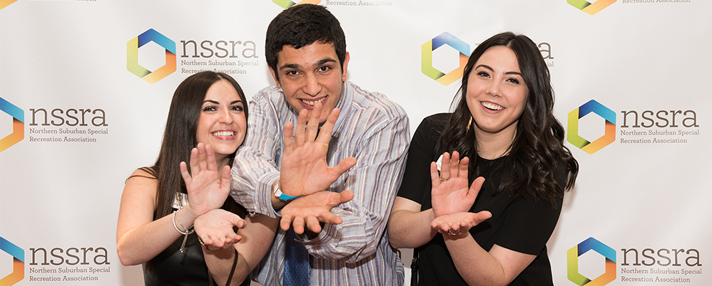 Man and two women posing together at NSSRA event